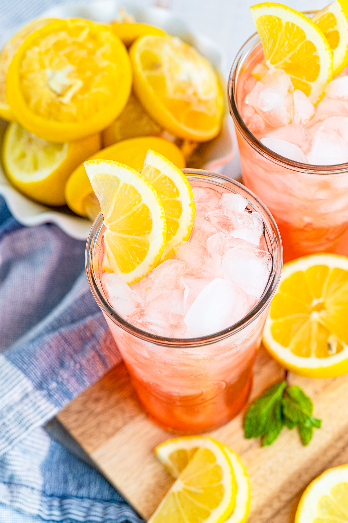 Overhead of one glass of Pink Lemonade showing the ice and lemon