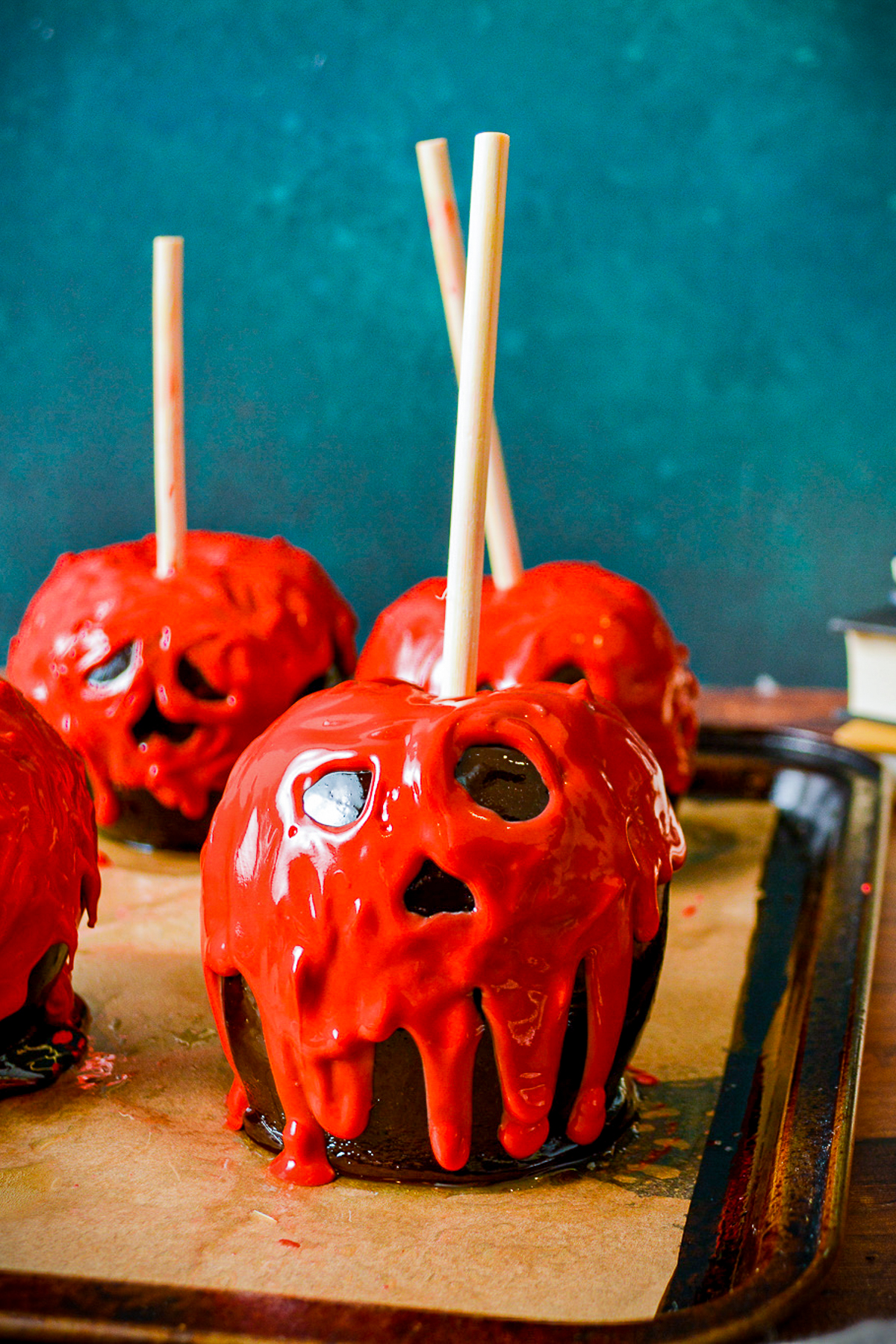 Finished Poison Apples on baking sheet on parchment paper.