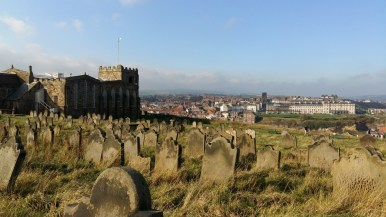 Gravestones and view to West Cliff