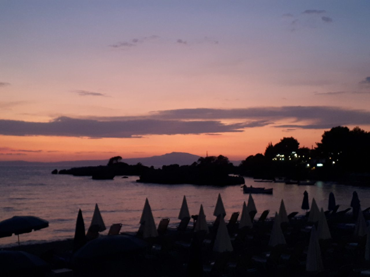 pink sunset over stoupa beach