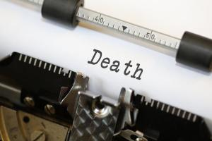 Let's talk about death - close up of typewriter with word death typed on white paper