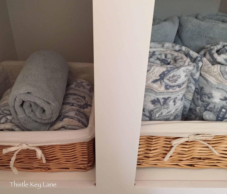 Repurposed baskets in guest bath