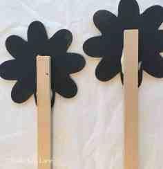Glue flowers to wooden sticks