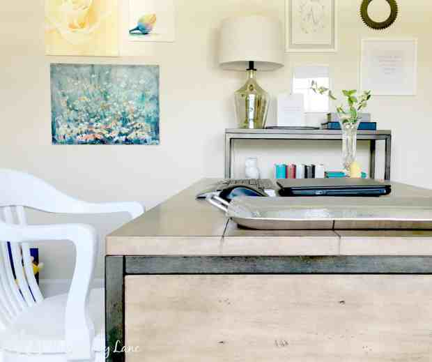 Mixing styles with a library chair and an industrial desk.