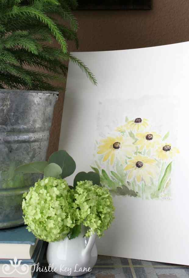 Free printable! Spring watercolor displayed in a vignette.
