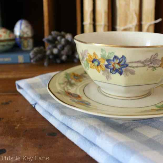 Pretty Limoges tea cup with French inspiration.
