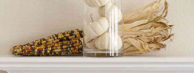 Decorating the mantel with a simple pumpkin mantel.