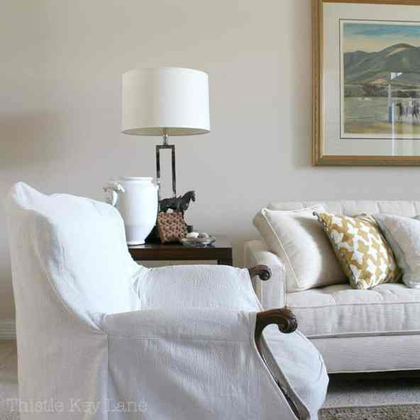 Mixed decor with slip covered furniture.