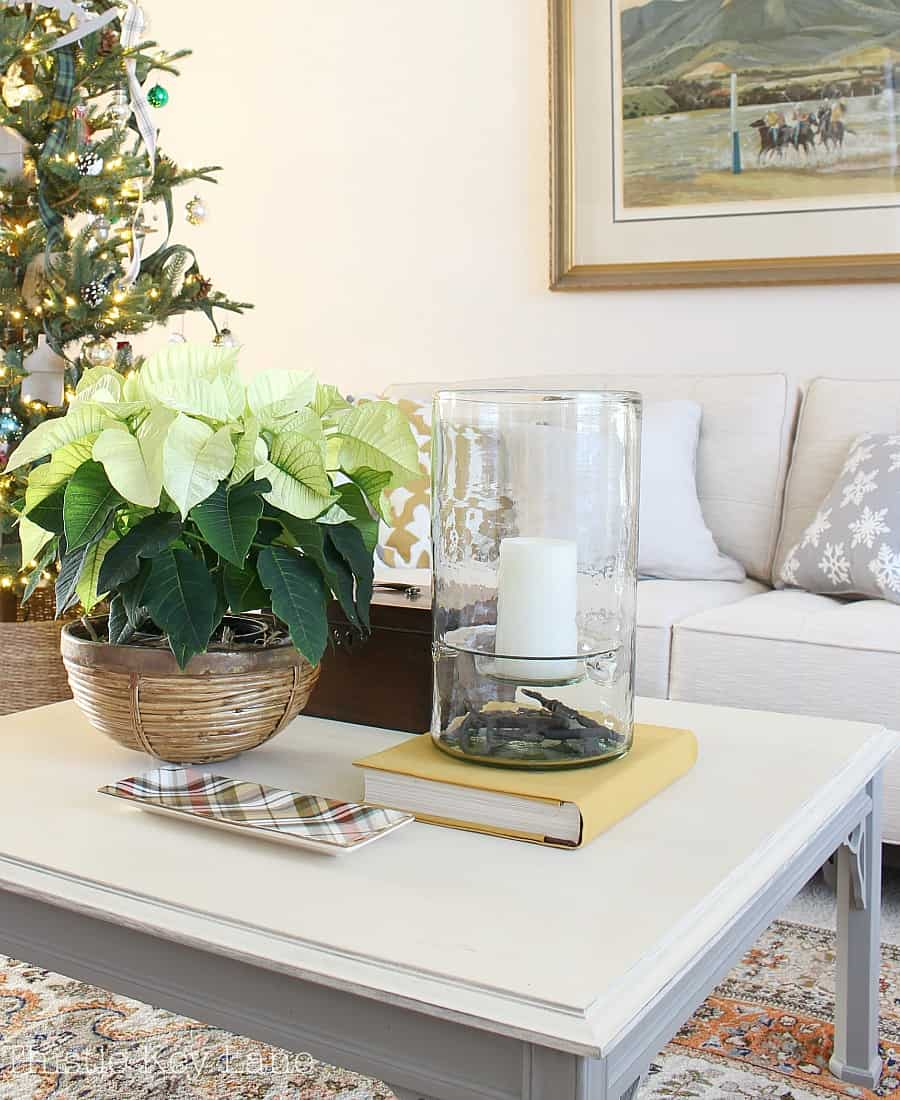 Holiday coffee table with a yellow poinsettia.