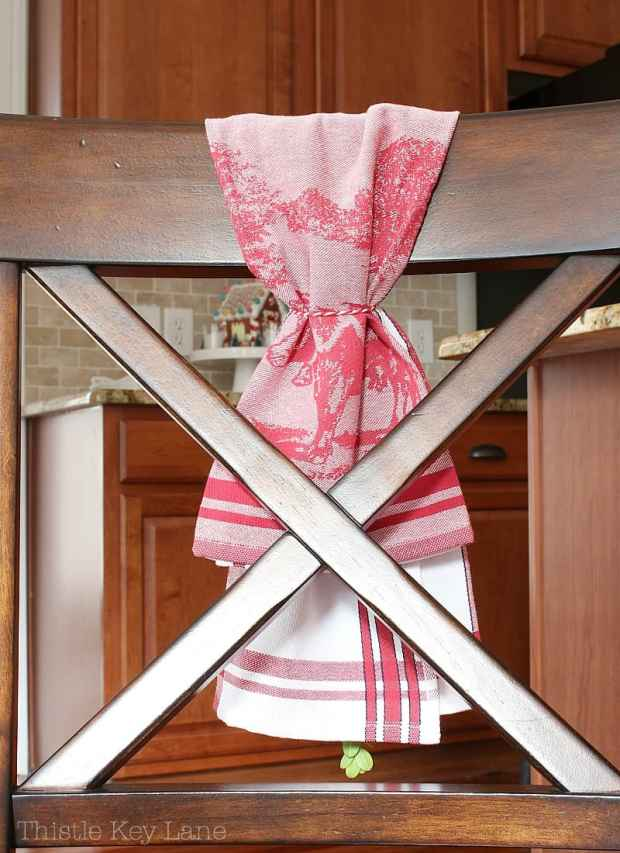 Use a kitchen towel to decorate a chair.