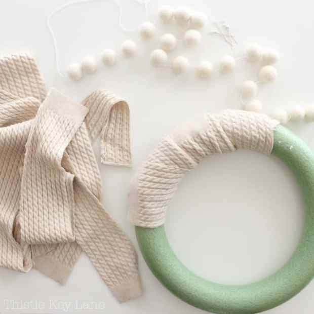Cut a sweater in strips to wrap around a wreath form.