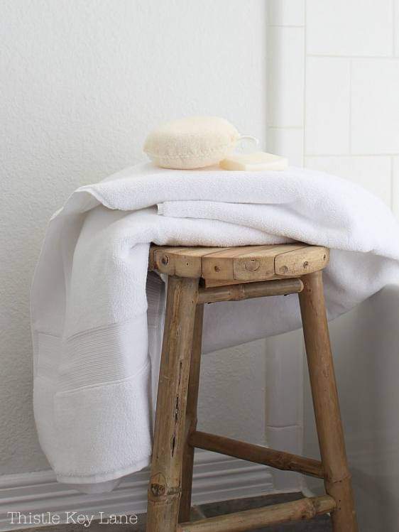 Bamboo stool sits outside the shower.