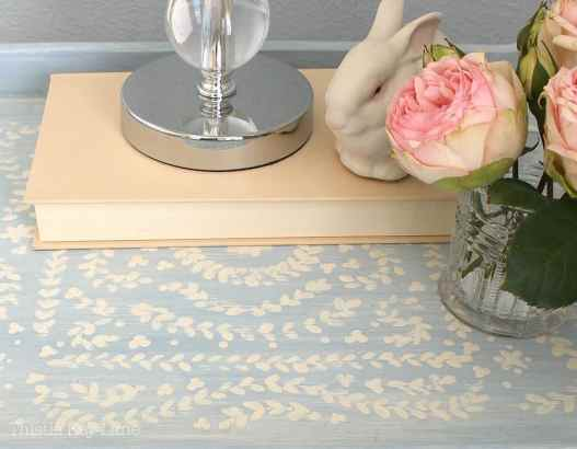 A tray table with a painted design.