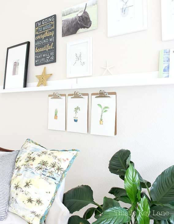 Gallery wall is has simple and fun art.
