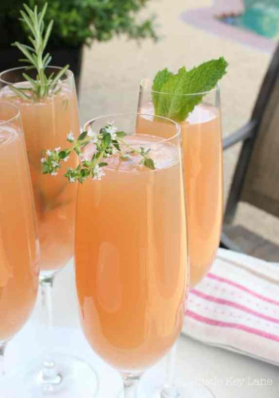 Garnish Grapefruit Mimosas with fresh herbs.