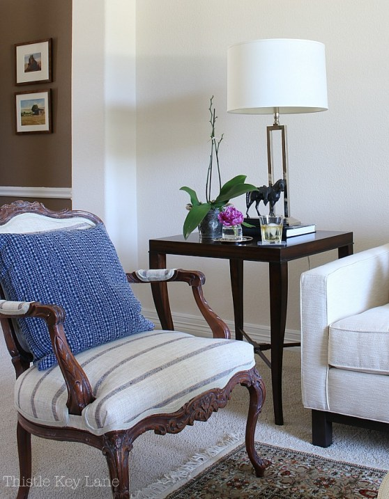 Summer home tour with blue and white accents on a French style chair.