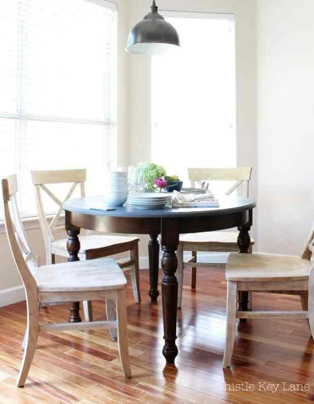 Light finish of the chairs with the dark kitchen table looks great.
