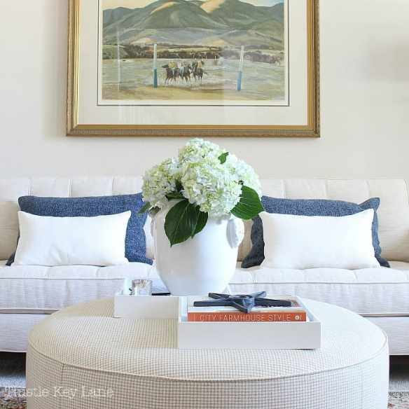 Summer home tour with blue and white accents on the sofa.