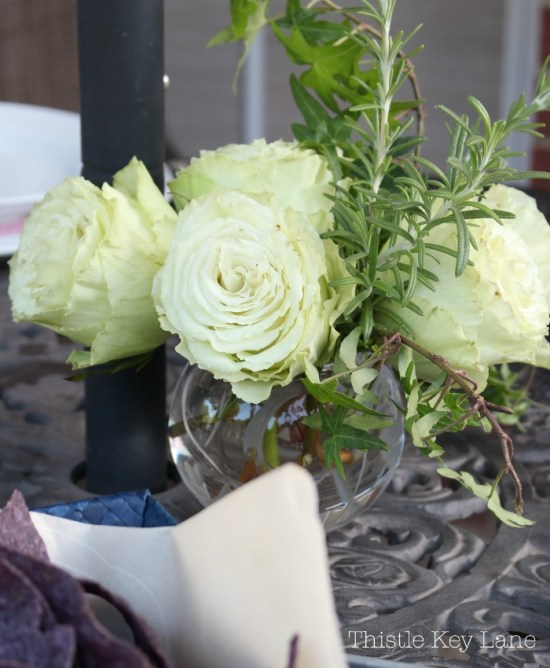 Roses with rosemary for a little patio bouquet.