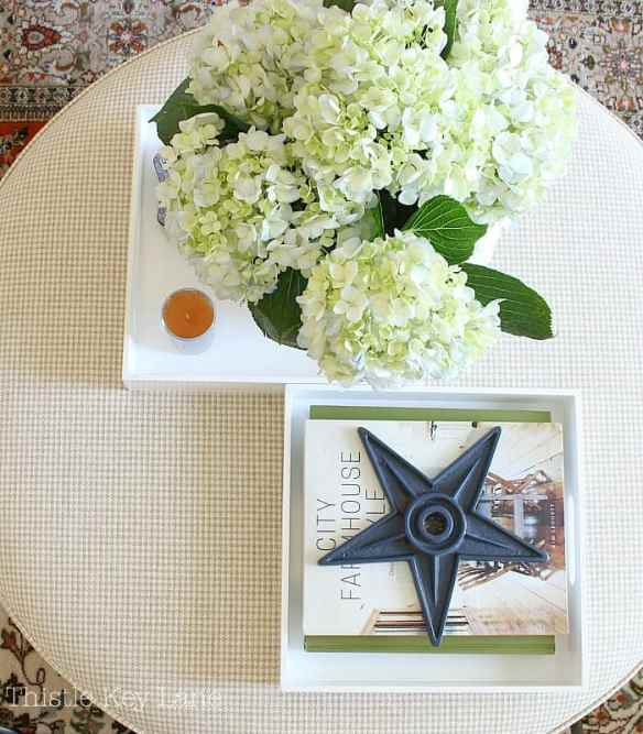 Summer home tour with blue and white accents on the coffee table ottoman.