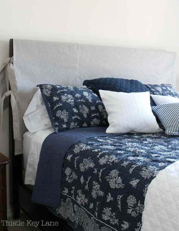 Ticking strips on the slipcover go mix with our bedding choices.