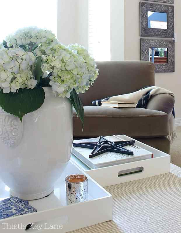 Summer home tour with blue and white accents chairs and ottomans.