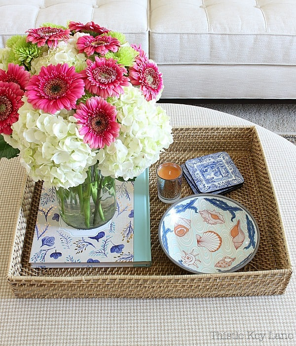 Style an ottoman with a tray filled with your favorites.