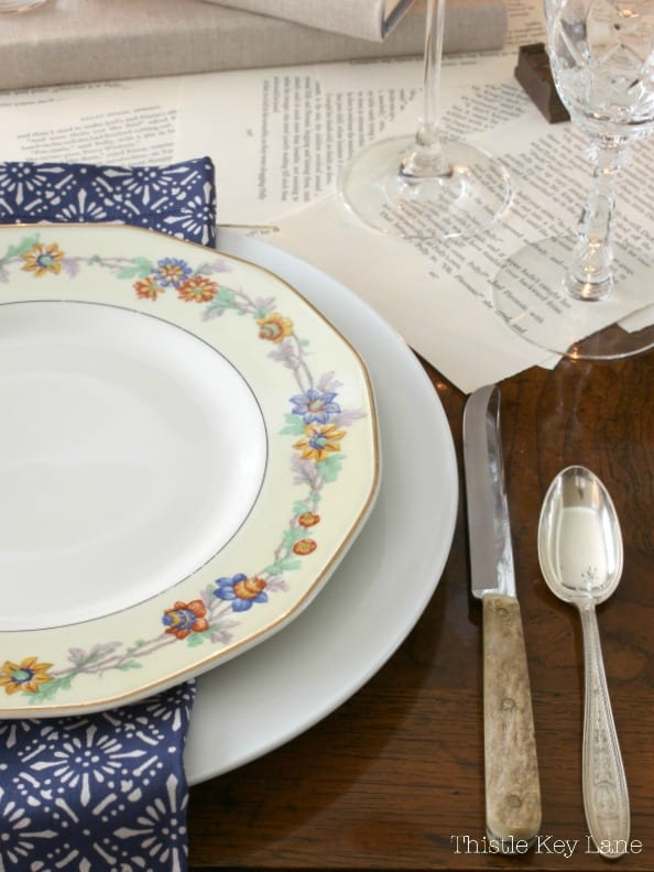 Tablescape using a book page table runner and vintage china.