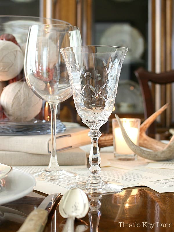 Tablescape using a book page table runner and vintage glasses.