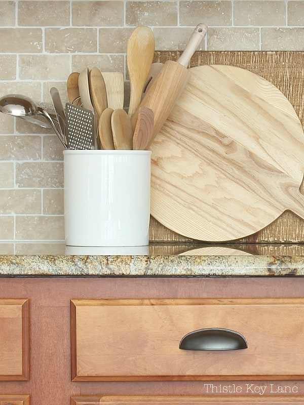 Bread boards and a plain white crock for utensils.