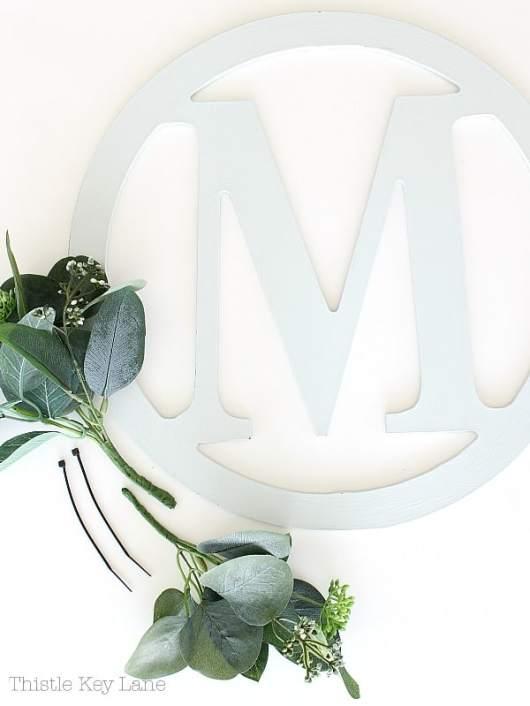 Initial cutout wreath with eucalyptus.
