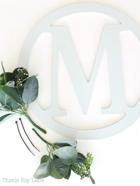 Initial cutout wreath with eucalyptus.