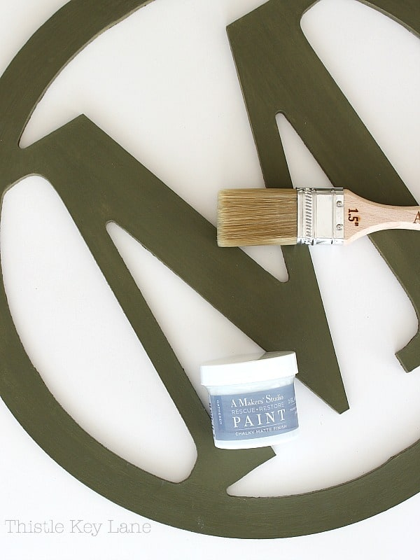 Paint brush and paint to update an initial wreath.