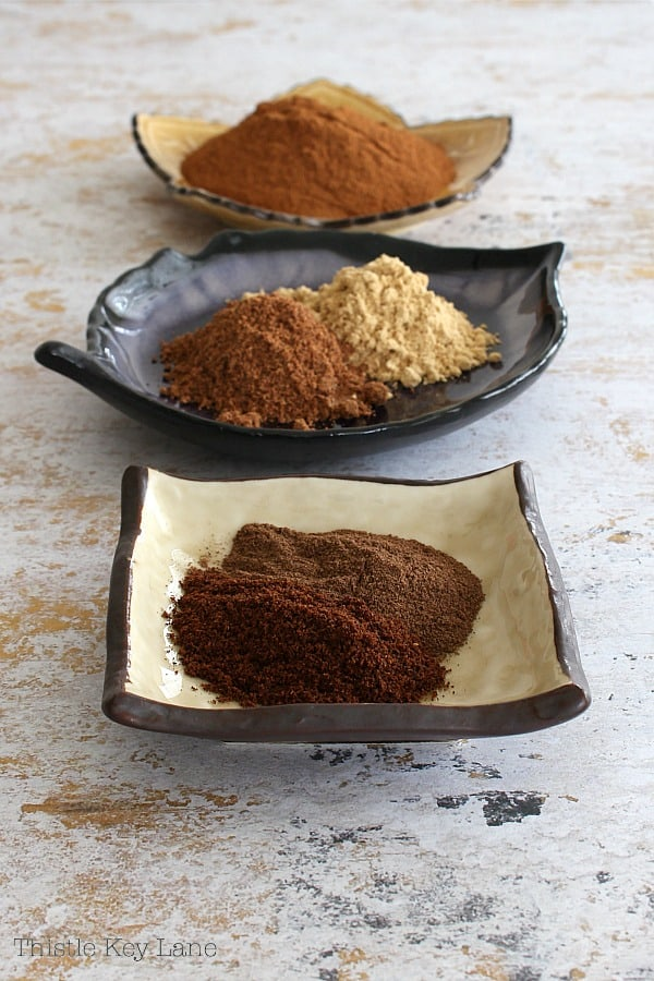 Spices cinnamon, ginger, nutmeg, cloves and allspice in open dishes. Freshest spices for your pumpkin spice recipe.