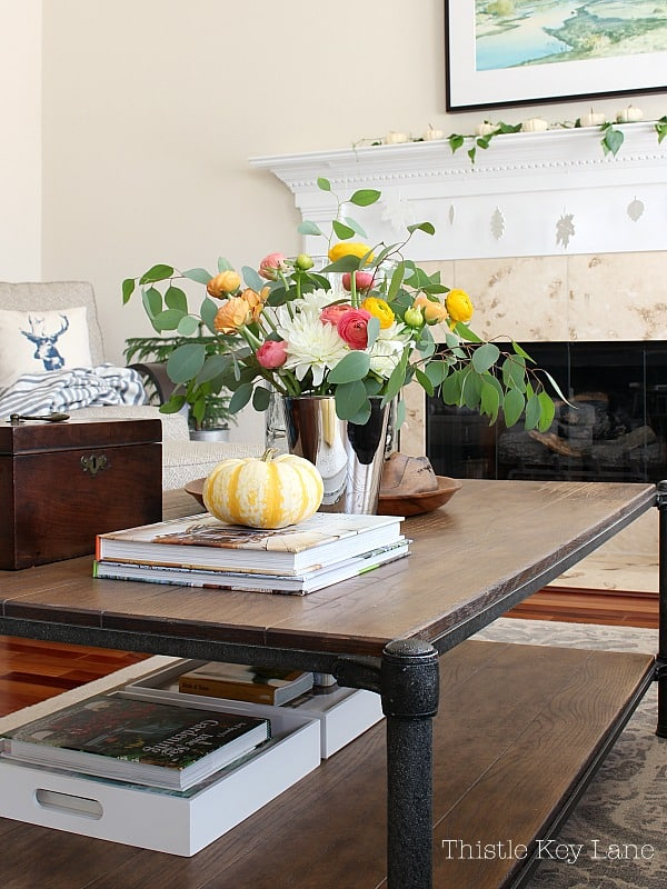 Orange, yellow and peach flowers set the stage on the coffee table.