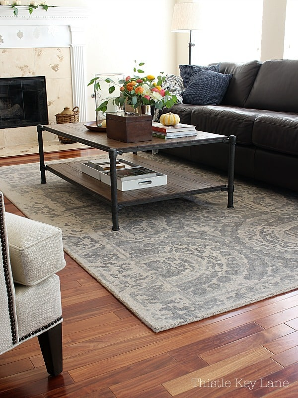 Gray rug looks beautiful with wood tones.