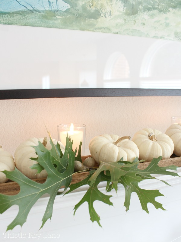 Oak leaves, acorns and pumpkins on the mantel.