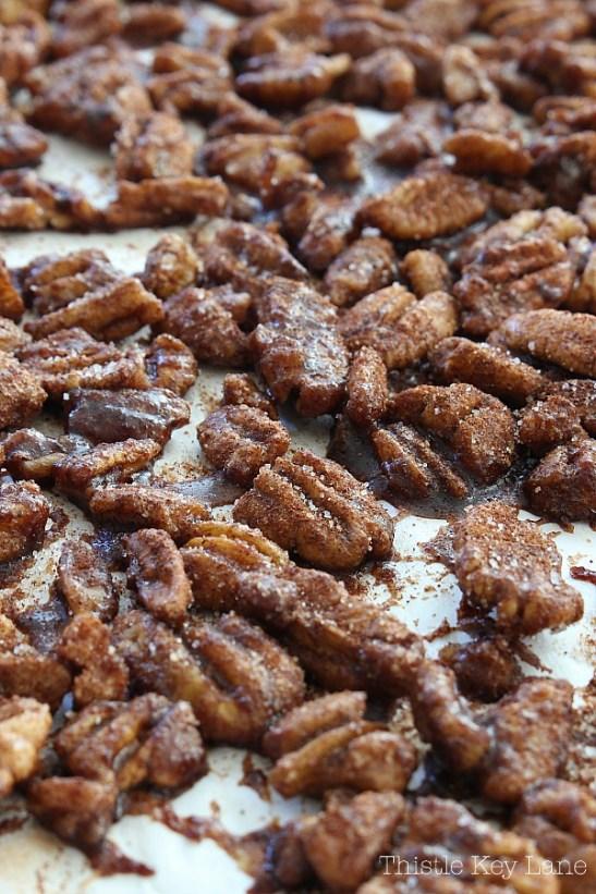 Candied pecans on parchment paper.