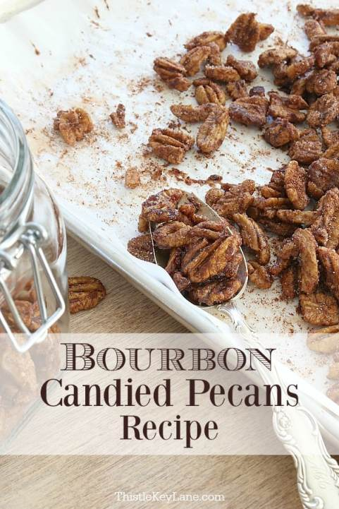 Spoonful of candied pecans on baking tray.