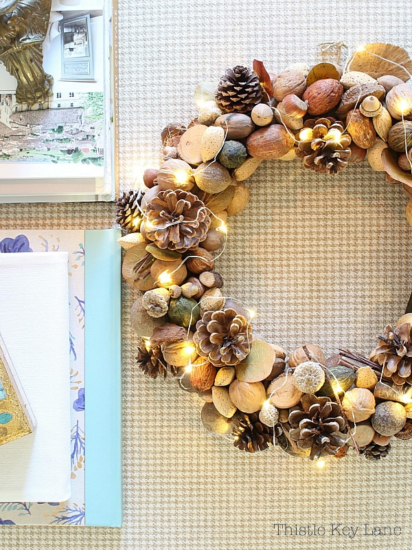 Natural wreath with unshelled nuts, acorn, pinecones and fairy lights.