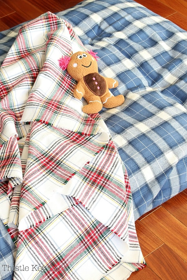 Plaid dog bed cover, coordinating blanket and dog toy.