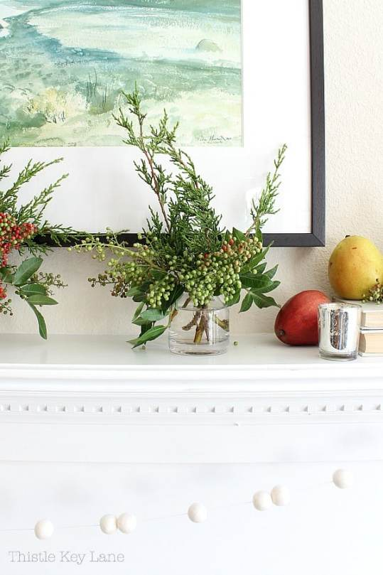 Pepper berry arrangements and pears on the mantel.