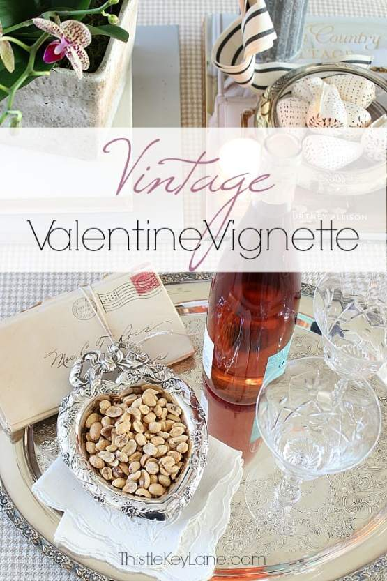 Valentine vignette with vintage silver, letters, crystal glasses and wine.