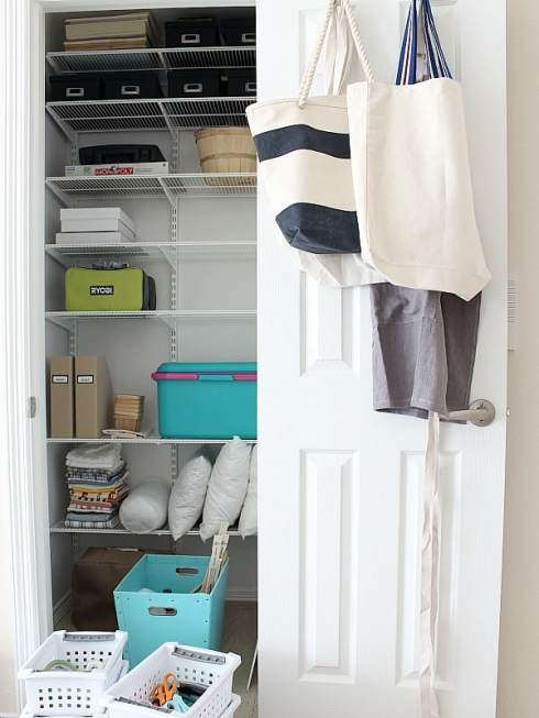 Craft closet with shelves.