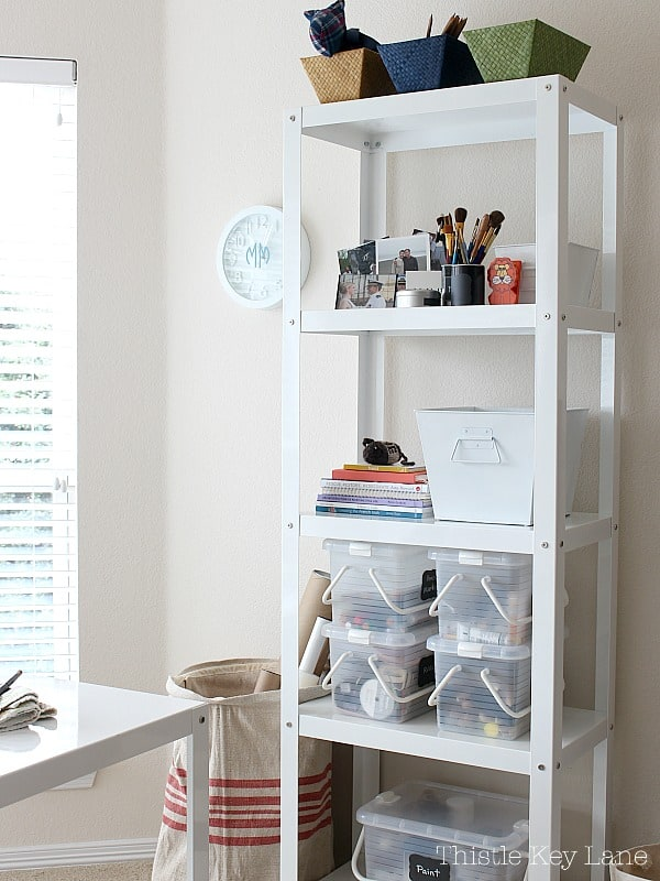 White metal storage tower with craft supplies.