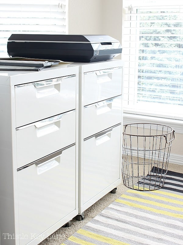 White metal file cabinets for craft storage.