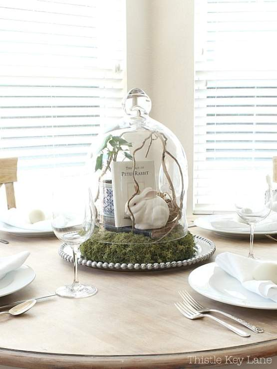 Neutral spring tablescape with vintage cloche vignette.