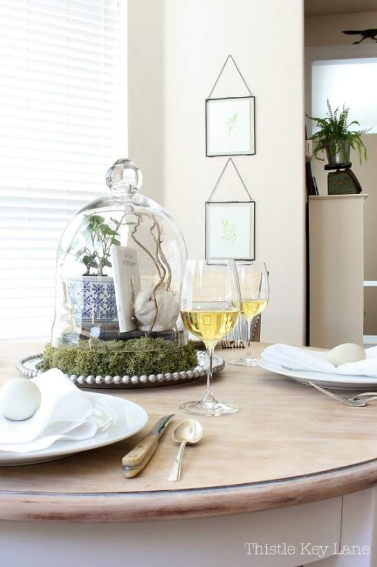 Vintage inspired collectables under a glass cloche for a spring home tour.