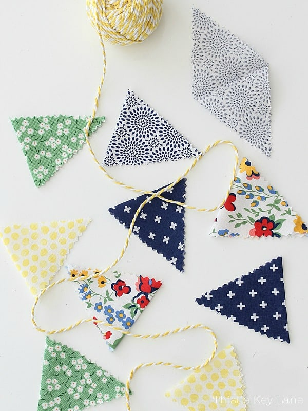 Fabric triangles for bunting on white background.