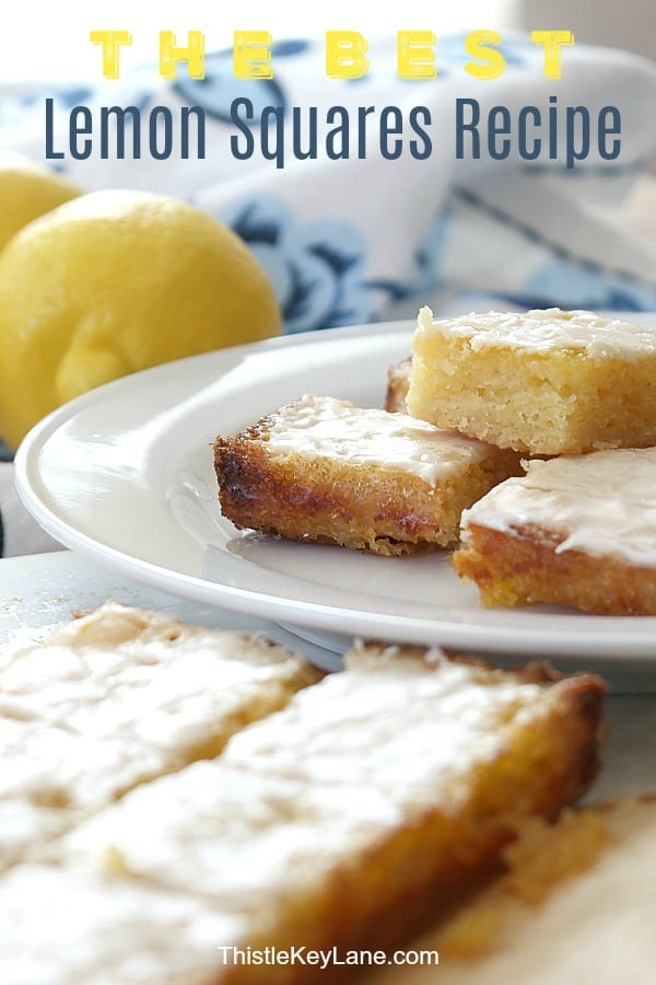 Batch of lemon squares recipe cut to serve on white plate.